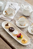 A table laid with petit fours and tea