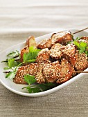 Salmon and apple skewers with soy, ginger and sesame seeds