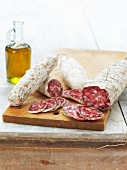 Sliced salami on a chopping board