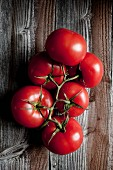 Vine tomatoes on a wooden surface