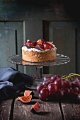 A homemade tart with red grapes, figs and whipped cream