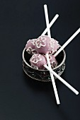Cake pops decorated with iced flowers