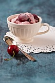 Homemade cherry ice cream in a cup