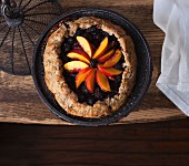 Blackberry and peach galette on a wooden table