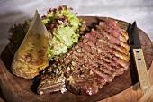 A sliced beef steak with fresh horseradish