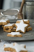Cinnamon stars on a rustic pewter plate