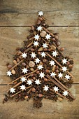 A Christmas tree made from star anise, nuts, cinnamon sticks, cloves and cinnamon star biscuits