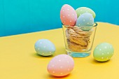 Colourful Easter eggs with white polka dots