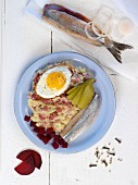 Labskaus (traditional dish from Northern Germany featuring herring, egg and gherkins)