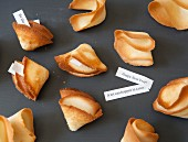 Homemade fortune cookies with fortunes for the New Year