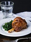 Roasted knuckle of lamb with spinach