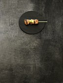 Grilled meat kushi on a bamboo skewer