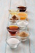 Natural sweeteners: sugar, cane sugar, maple syrup, stevia, coconut flower sugar, honey, agave syrup and sugar beet syrup