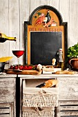 Still-life kitchen arrangement with typical Italian ingredients & chalkboard