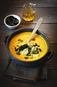 Pumpkin soup with roasted bok choy and pumpkin seeds