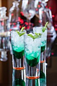 Cocktails with mint liqueur, ice, fresh mint and soda water