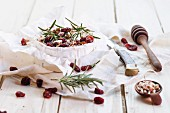 Baked Camembert with nuts, cranberries, rosemary and honey being made