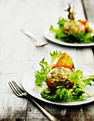 Stuffed tomatoes on lettuce