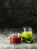 A spinach smoothie and a blueberry smoothie