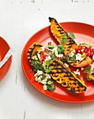 Grilled butternut squash with coriander pesto, pomegranate, sheep's cheese and pistachios