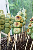 Grilled green tea dango on skewers (Japan)