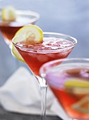 Cosmopolitans (cocktails made with vodka, orange liqueur, cranberry and lime juice)