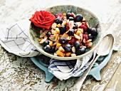 Fruit salad garnished with a rose