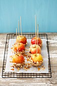 Toffee apples with chopped nuts