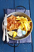 Pork escalope with chips and lemon