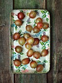 Fresh gooseberries on a vintage tray