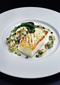 Turbot fillet with spinach and a caper sauce
