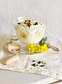 Banana pudding with sponge fingers in a glass bowl