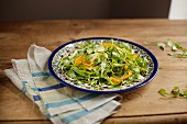 Rocket salad with persimmon and Parmesan cheese