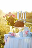 A table laid in the countryside for a romantic breakfast for two