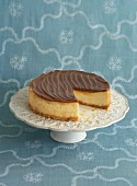 Cheesecake on a cake stand, sliced