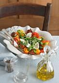 Tomato salad with mozzarella, rocket and basil