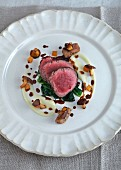 Venison medallions with gnocchi and mushrooms (seen from above)