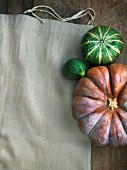 Pumpkin and courgettes on a linen cloth