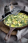 Courgette frittata in a pan