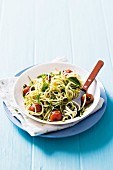 Noodles with tomatoes, pesto and basil