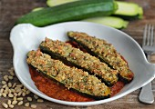 Stuffed courgette with tomato sauce