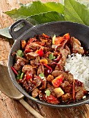 Lomo Saltado (beef ragout, Peru) with rice