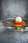 An aloe vera snowball with panna cotta and strawberries at the restaurant Meierei Dirk Luther