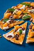 A sweet pizza with persimmons and nuts
