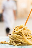 Spaghettone with anchovies, pistachio nuts and lemon zest from the restaurant Farmacia dei sani in Ruffano, Italy