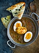 Egg curry with naan bread