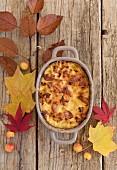 Autumnal pumpkin gratin in a baking dish