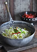 Stir-fried rice noodles with chillis (India)