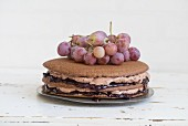 Chocolate cake with great charm, chocolate cream and red grapes