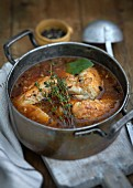Chicken in white wine with thyme and bay leaves